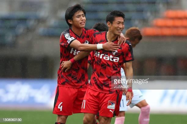 Hayato Asakawa of Roasso Kumamoto celebrates scoring his side's first goal with his team mate Shuichi Sakai during the J.League Meiji Yasuda J3 match...