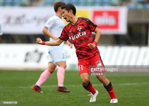 Hayato Asakawa of Roasso Kumamoto celebrates scoring his side's first goal during the J.League Meiji Yasuda J3 match between Roasso Kumamoto and...