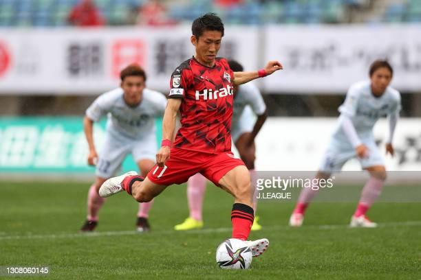 Hayato Asakawa of Roasso Kumamoto coverts the penalty to score his side's first goal during the J.League Meiji Yasuda J3 match between Roasso...