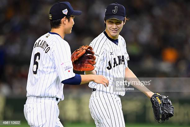 Hayato Sakamoto of Japan celebrates with Shota Takeda in the top half of the second inning during the WBSC Premier 12 third place play off match...