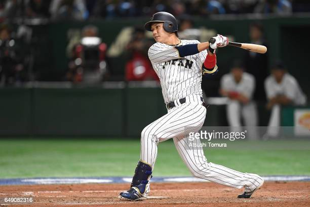 Hayato Sakamoto of Japan hits a RBI double in the fifth inning of the World Baseball Classic Pool B Game One between Cuba and Japan at Tokyo Dome on...