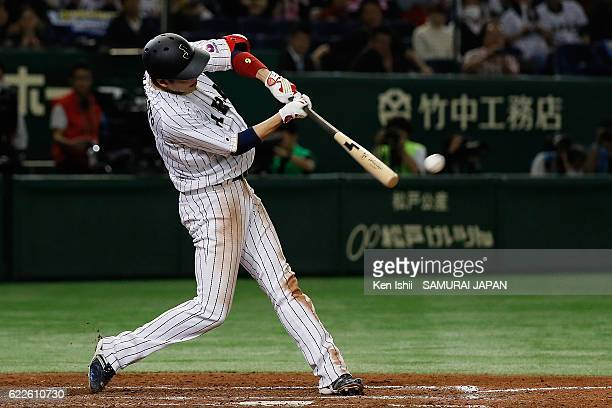 Hayato Sakamoto of Japan hits a threerun double in the fifth inning during the international friendly match between Japan and Netherlands at the...