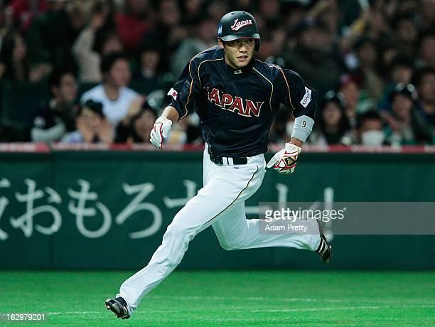 Hayato Sakamoto of Japan runs between bases during the World Baseball Classic First Round Group A game between Brazil and Japan at Fukuoka Yahoo...
