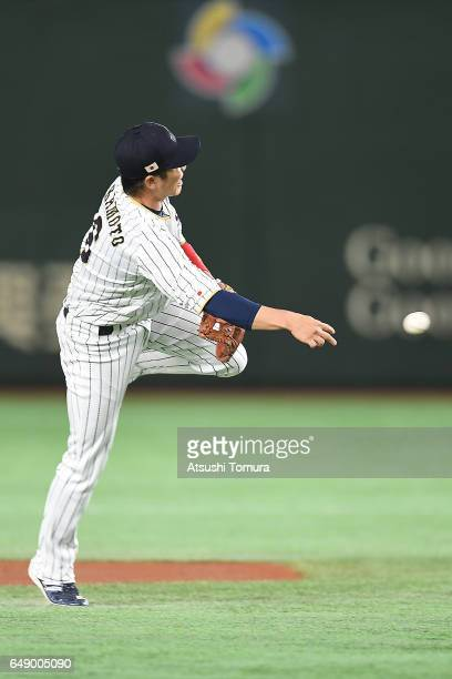 Hayato Sakamoto of Japan throws in the first inning of the World Baseball Classic Pool B Game One between Cuba and Japan at Tokyo Dome on March 7...