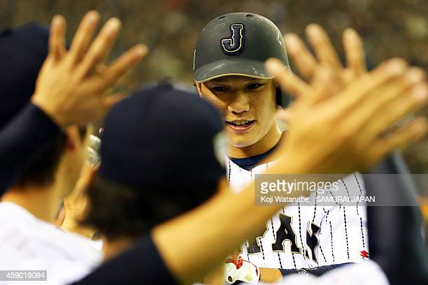 Hayato Sakamoto of Samurai Japan celebrates upon coming back home after hitting a two-run homer in the second inning during the game three of Samurai...