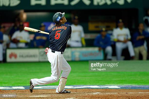 Hayato Sakamoto of Team Japan hits a sacrifice fly in the top of the fourth inning during Pool A Game 1 between Team Japan and Team Brazil during the...
