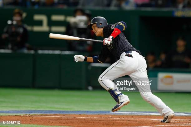 Hayato Sakamoto of Team Japan hits doubles in the fifth inning during Game 3 of Pool B against Team Australia at the Tokyo Dome on Wednesday March 8...