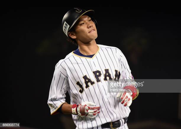 Hayato Sakamoto of team Japan reacts to his groundout in the ninth inning against the United States during Game 2 of the Championship Round of the...