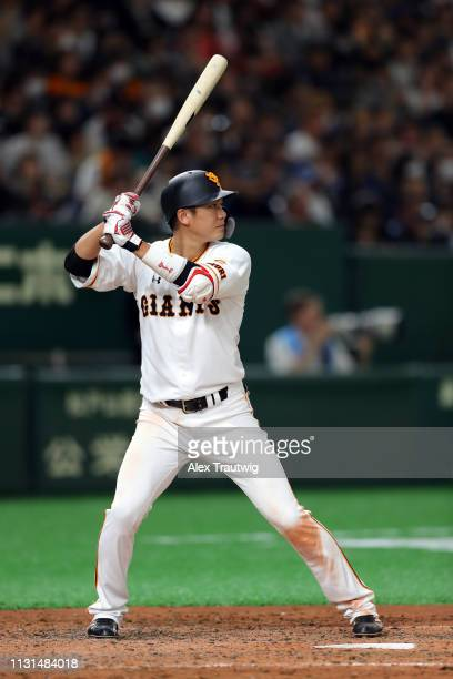 Hayato Sakamoto of the Yomiuri Giants bats during an exhibition game against the Seattle Mariners for the 2019 Opening Series at the Tokyo Dome on...