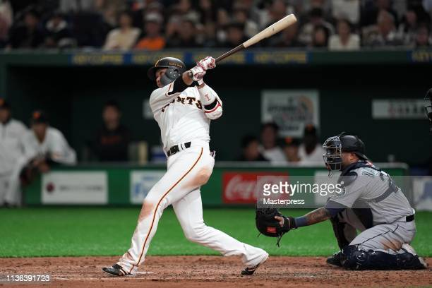 Hayato Sakamoto of the Yomiuri Giants hits a solo homer in the bottom of 5th inning during the game between the Yomiuri Giants and Seattle Mariners...