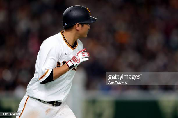 Hayato Sakamoto of the Yomiuri Giants rounds the bases after hitting a home run during an exhibition game against the Seattle Mariners for the 2019...