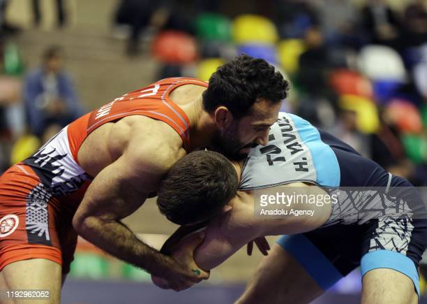 Haydar Yavuz of Turkey competes with Servet Coskun of Turkey in Men's freestyle 70 kilograms match at the 48th International Yasar Dogu Freestyle...
