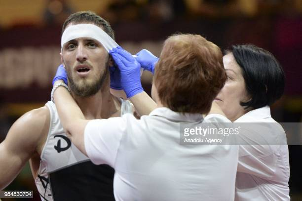 Haydar Yavuz of Turkey is seen after he injured during the men's 70 kg category match against Magomedmurad Gadzhiev of Poland within the 2018...