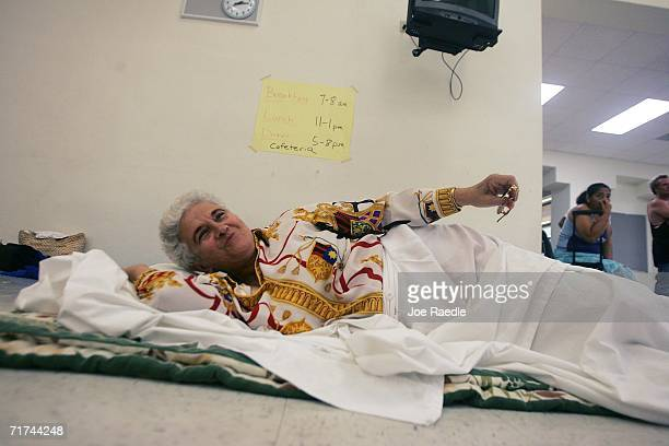 Haydee Gonzalez rests at the Booker T Washington Senior High School Red Cross evacuation shelter as Tropical Storm Ernesto approaches August 29 2006...