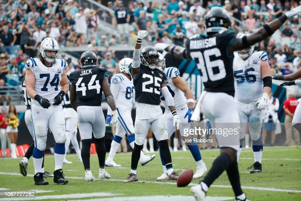 Hayden and Ronnie Harrison of the Jacksonville Jaguars celebrate a stop near the goal line during their game against the Indianapolis Colts at TIAA...