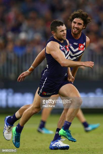 Hayden Ballantyne and Alex Pearce of the Dockers celebrate a goal during the round five AFL match between the Fremantle Dockers and the Western...