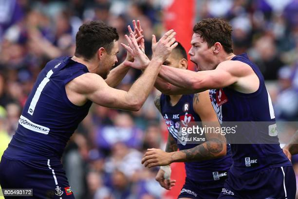 Hayden Ballantyne and Lachie Neale of the Dockers celebrate a goal during the round 15 AFL match between the Fremantle Dockers and the St Kilda...