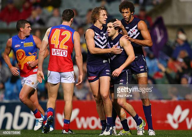 Hayden Ballantyne of the Dockers is congratulated by Chris Mayne after kicking a goal during the round 14 AFL match between the Fremantle Dockers and...