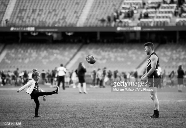 Hayden Ballantyne of the Dockers kicks the football with daughter Avery during the 2018 AFL round 23 match between the Fremantle Dockers and the...