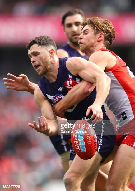 Hayden Ballantyne of the Dockers tackled during the round 21 AFL match between the Sydney Swans and the Fremantle Dockers at Sydney Cricket Ground on...