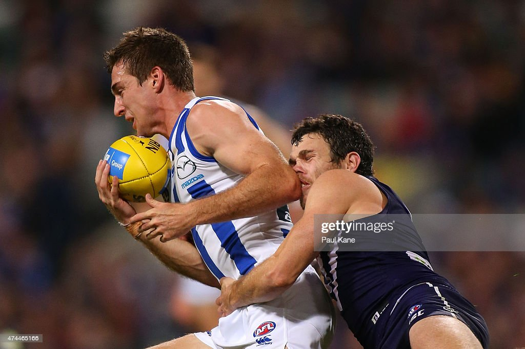 Hayden Ballantyne of the Dockers trackles Shaun Atley of the Kangaroos during the round eight AFL match between the Fremantle Dockers and the North Melbourne Kangaroos at Domain Stadium on May 23, 2015 in Perth, Australia.