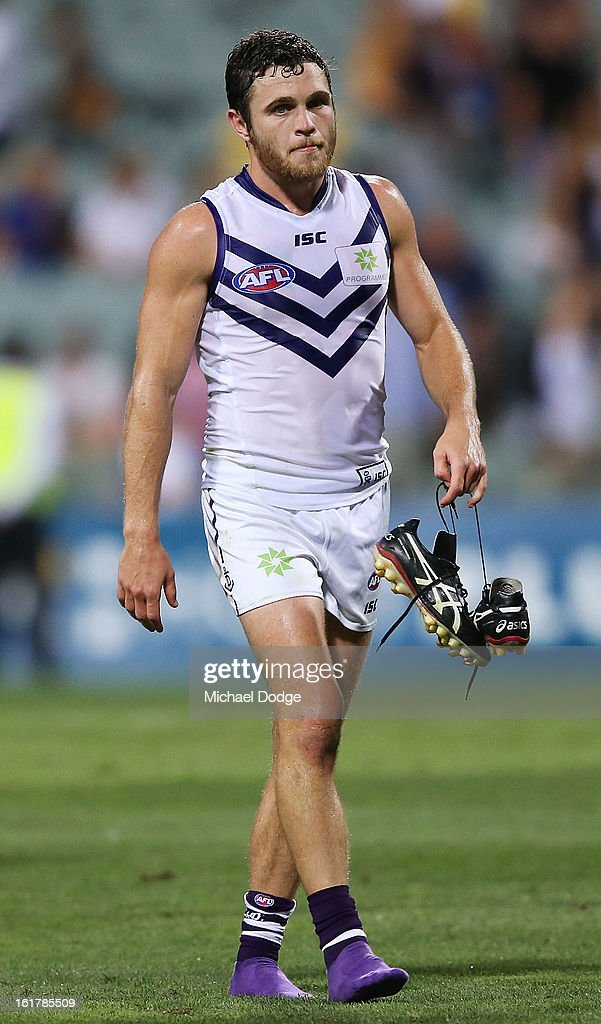 Hayden Ballantyne of the Fremantle Dockers walks off after their loss in the round one NAB Cup match between the West Coast Eagles and the Fremantle Dockers at Patersons Stadium on February 16, 2013 in Perth, Australia.