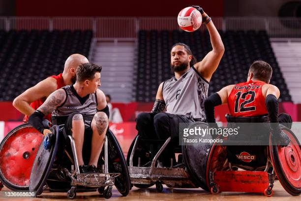 Hayden Barton-Cootes of Team New Zealand fights for the ball against Team Canada during a group A wheelchair rugby match four on day 3 of the Tokyo...
