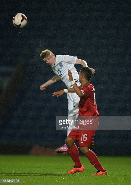 Hayden Coulson of England is challenged by Centeno of Portugal during the Under 17 International match between England U17 and Portugal U17 at Proact...