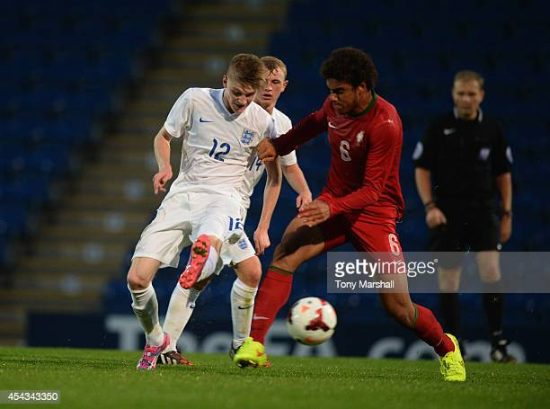 Hayden Coulson of England is tackled by Pedro Ferreira of Portugal during the Under 17 International match between England U17 and Portugal U17 at...