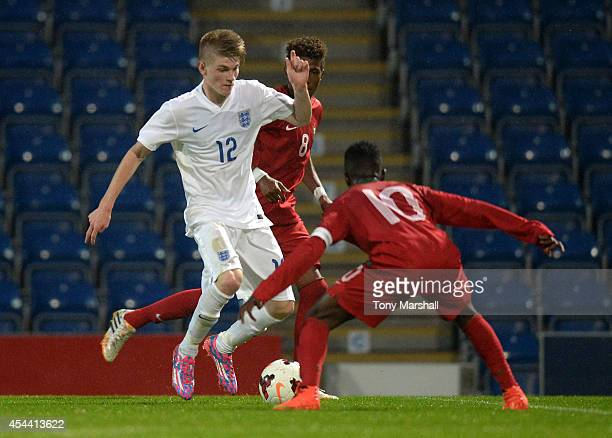 Hayden Coulson of Englandlooks to get past Moreto of Portugal during the Under 17 International match between England U17 and Portugal U17 at Proact...