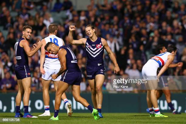 Hayden Crozier Michael Walters and Nathan Fyfe of the Dockers celebrate a goal during the round three AFL match between the Fremantle Dockers and the...