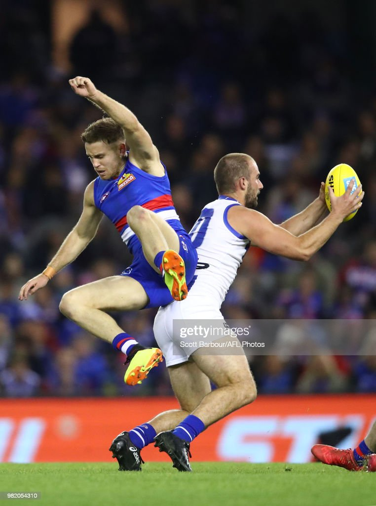 Hayden Crozier of the Bulldogs and Ben Cunnington of the Kangaroos compete for the ball during the round 14 AFL match between the Western Bulldogs and the North Melbourne Kangaroos at Etihad Stadium on June 23, 2018 in Melbourne, Australia.