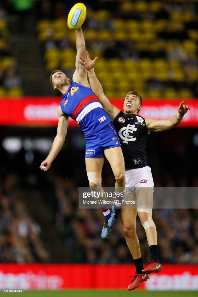 Hayden Crozier of the Bulldogs and Patrick Cripps of the Blues compete for the ball during the 2018 AFL round six match between the Western Bulldogs and the Carlton Blues at Etihad Stadium on April 27, 2018 in Melbourne, Australia.