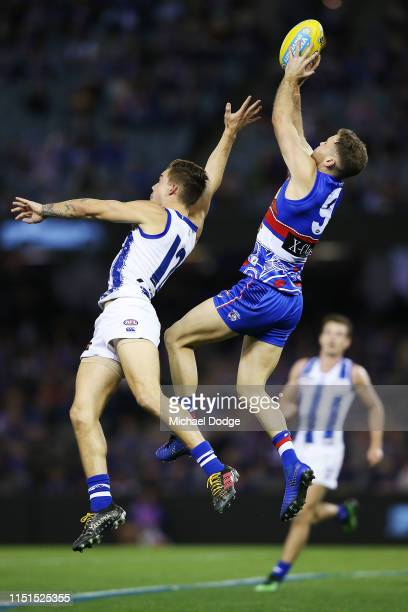 Hayden Crozier of the Bulldogs marks the ball against Jy Simkin of the Kangaroos during the round 10 AFL match between the Western Bulldogs and the...