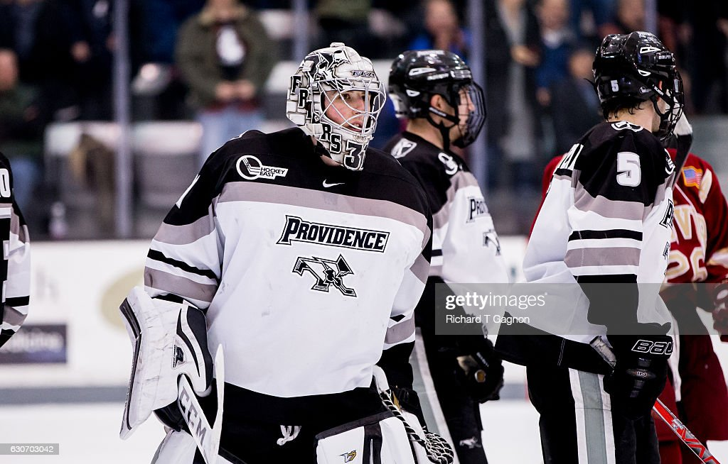 Hayden Hawkey #31 of the Providence College Friars is greeted by his teammates after a 2-2 tie against the Denver Pioneers NCAA hockey at the Schneider Arena on December 30, 2016 in Providence, Rhode Island.