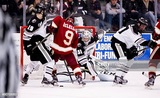 Hayden Hawkey of the Providence College Friars makes a save against Tyson McLellan of the Denver Pioneers during NCAA hockey at the Schneider Arena...