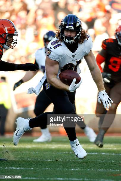 Hayden Hurst of the Baltimore Ravens runs with the ball during the game against the Cleveland Browns at FirstEnergy Stadium on December 22 2019 in...