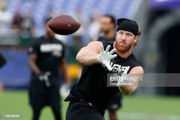Hayden Hurst of the Baltimore Ravens warms up prior to a preseason game against the Green Bay Packers at MT Bank Stadium on August 15 2019 in...