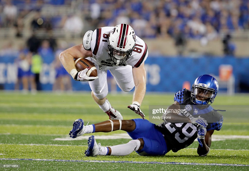 Hayden Hurst #81 of the South Carolina Gamecocks dives ahead for extra yards against the Kentucky Wildcats at Commonwealth Stadium on September 24, 2016 in Lexington, Kentucky.