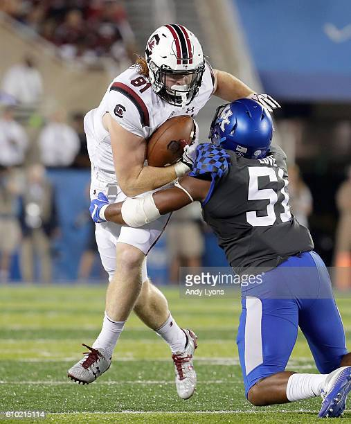 Hayden Hurst of the South Carolina Gamecocks runs ahead for extra yards against the Kentucky Wildcats at Commonwealth Stadium on September 24 2016 in...