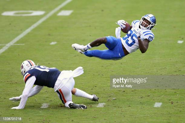 Hayden Mitchell of the Virginia Cavaliers tackles Damond Philyaw-Johnson of the Duke Blue Devils in the first half during a game at Scott Stadium on...