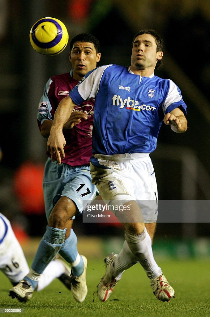 Hayden Mullins of West Ham is challenged by David Dunn of Birmingham City during the Barclays Premiership match between Birmingham City and West Ham United at St Andrews Road on December 5, 2005 in Birmingham, England.