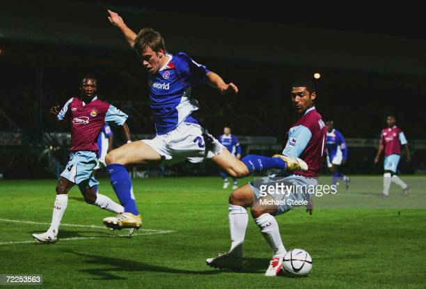Hayden Mullins of West Ham United beats Kevan Hurst of Chesterfield to the ball during the Carling Cup Third Round match between Chesterfield and...