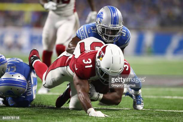 J Hayden of the Detroit Lions tackles David Johnson of the Arizona Cardinals in the second half at Ford Field on September 10 2017 in Detroit...