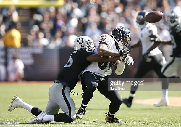 Hayden of the Oakland Raiders breaks a pass intended for Steve Smith of the Baltimore Ravens in the third quarter at Oakland-Alameda County Coliseum...
