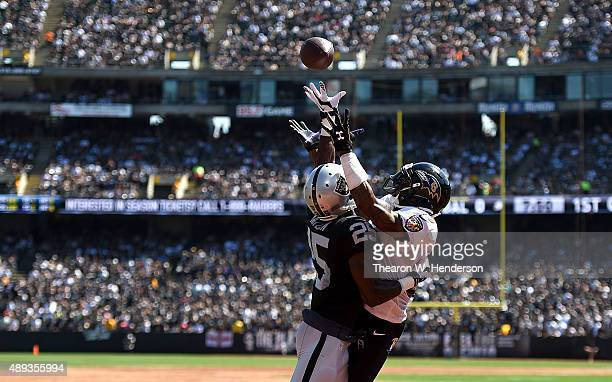 Hayden of the Oakland Raiders breaks up a pass intended for Steve Smith of the Baltimore Ravens in the first quarter at Oakland-Alameda County...