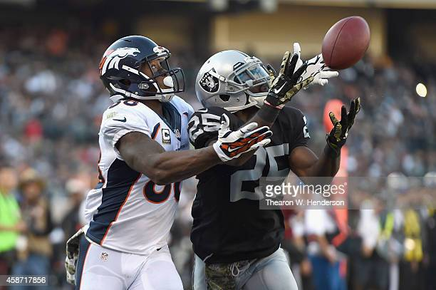 Hayden of the Oakland Raiders cannot complete the reception against the defense of Demaryius Thomas of the Denver Broncos in the third quarter at...