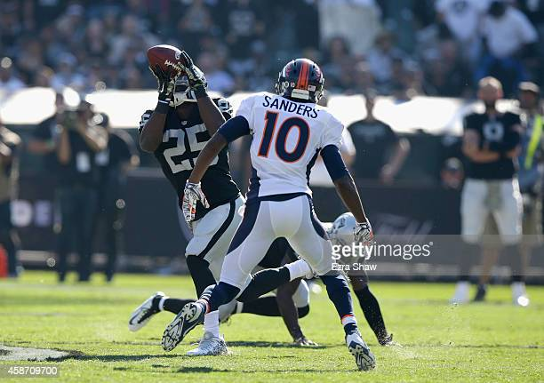 Hayden of the Oakland Raiders intercepts a pass against the Denver Broncos in the first half at O.co Coliseum on November 9, 2014 in Oakland,...