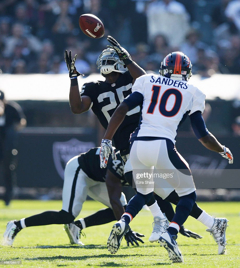 D.J. Hayden #25 of the Oakland Raiders intercepts the pass against the Denver Broncos in the first half at O.co Coliseum on November 9, 2014 in Oakland, California.