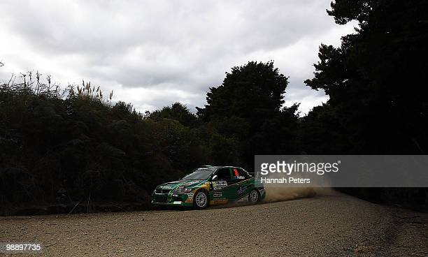 Hayden Paddon of New Zealand and co-driver John Kennard drive their Mitsubishi Lancer EVO X during stage 6 of the WRC Rally of New Zealand on May 7,...
